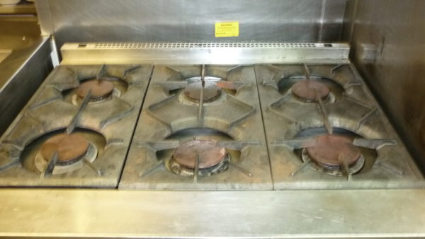 Kitchen Equipment Cleaning, Commercial Kitchen Hob - Commercial, Industrial and Domestic Kitchen Equipment / Industrial Oven Deep Cleaning throughout Preston, Blackpool, Cumbria, Lake District, Manchester, Liverpool, Chester, Lancashire and the North West.